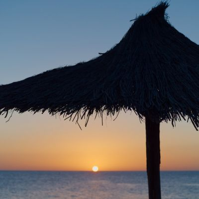 A thatched parasol at Sunset in Playa Blanca, Lanzarote