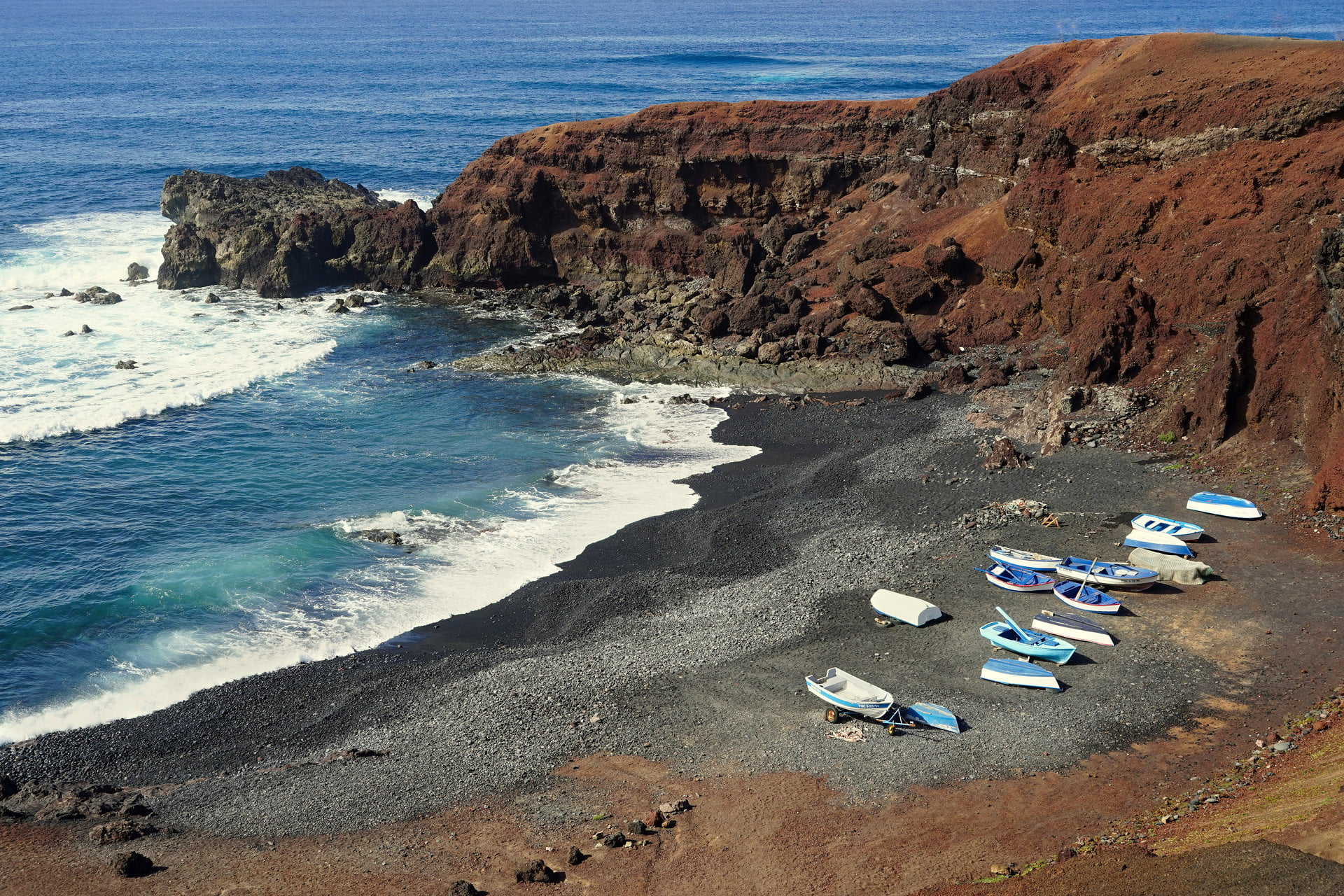 Small boats on a black beach near El Golfo, Lanzarote.