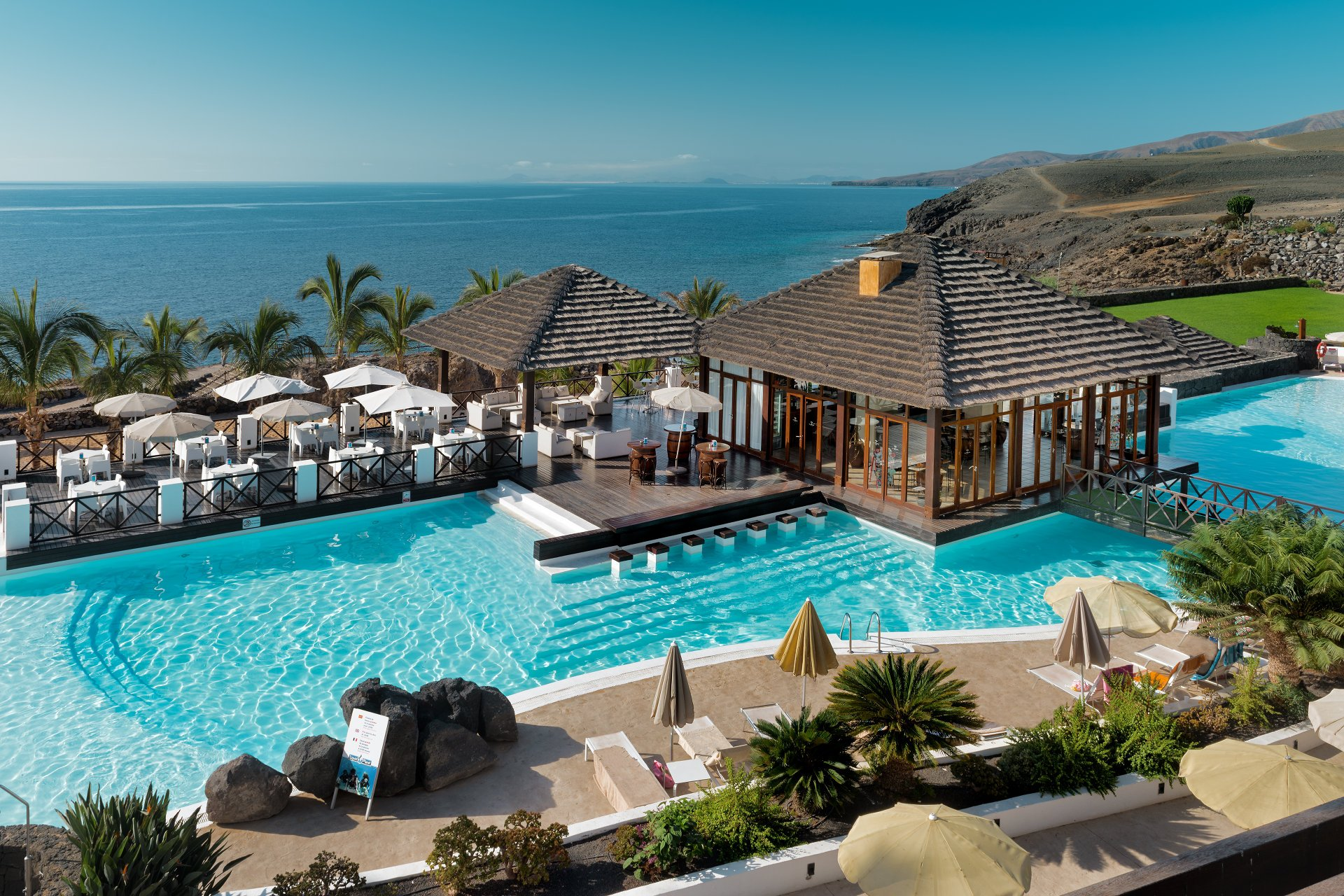 Swimming Pool, beach Bar and Sunbathing Terrace at Hesperia Lanzarote Hotel, Puerto Calero, Lanzarote