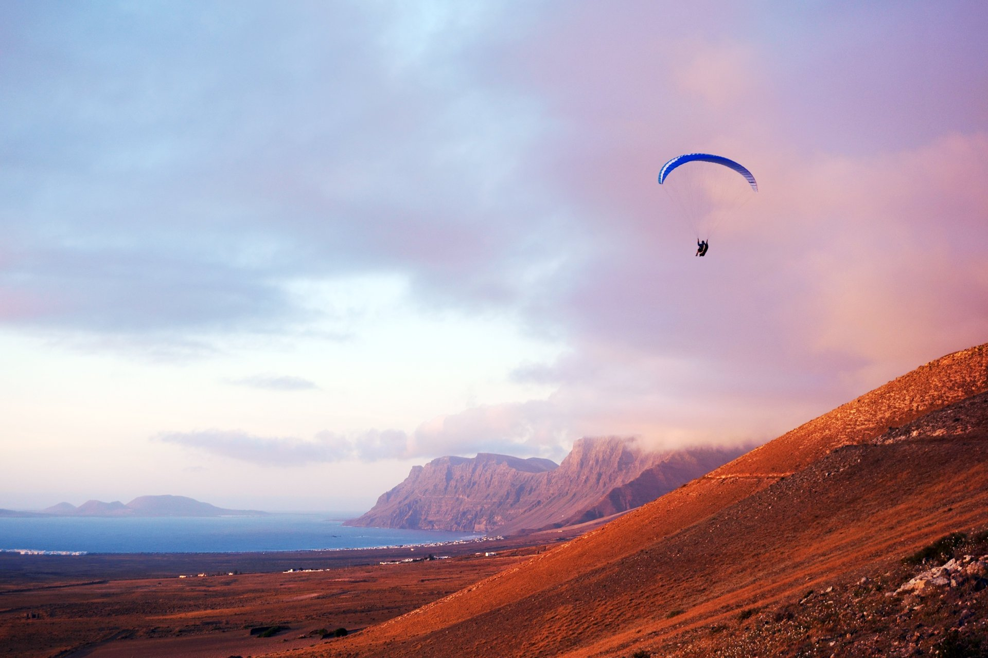 Paragliding from the cliffs of Risco de Famara in Lanzarote